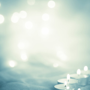 Glowing background with candle lights - Stock Image